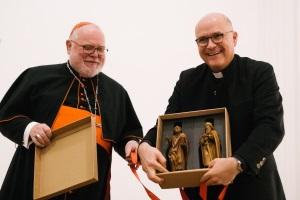 Kardinal Marx bei Verabschiedung von und mit Peter Beer