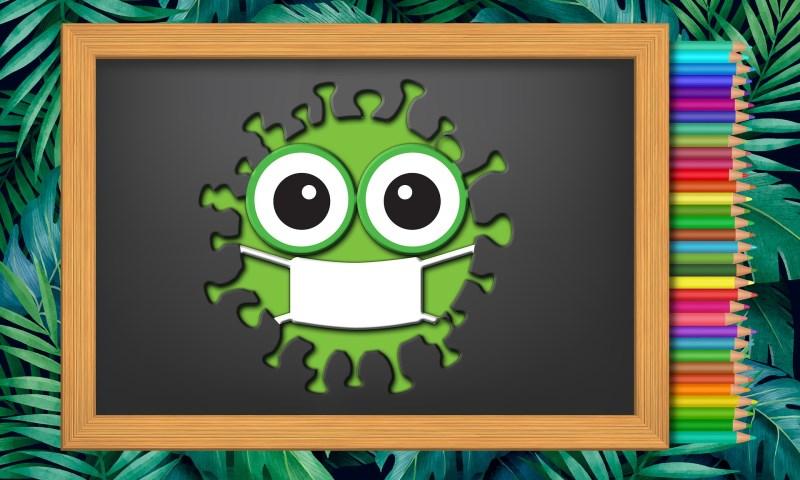Schultafel; bunte Stifte; grüner Virus mit Gesicht